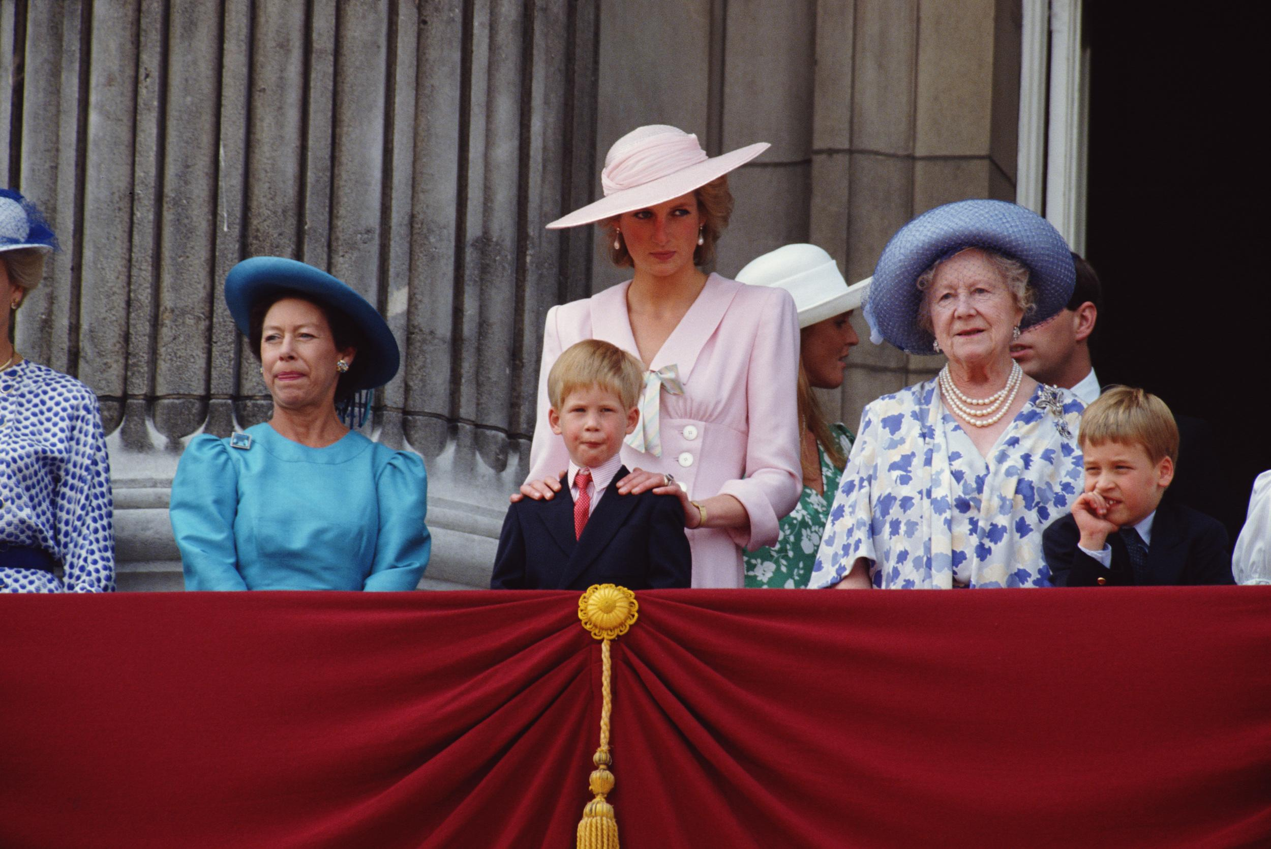Princess Diana (1961 - 1997, centre) wearing a Victor Edelstein dress as she watches the Trooping of the Colour from a balcony at Buckingham Palace, London, June 1989. Left to right: Princess Margaret (1930 - 2002), Prince Harry, Diana, the Queen Mother (1900 - 2002) and Prince William. Sarah Ferguson and Prince Andrew can be seen in the background (right). (Photo by Jayne Fincher/Princess Diana Archive/Getty Images)