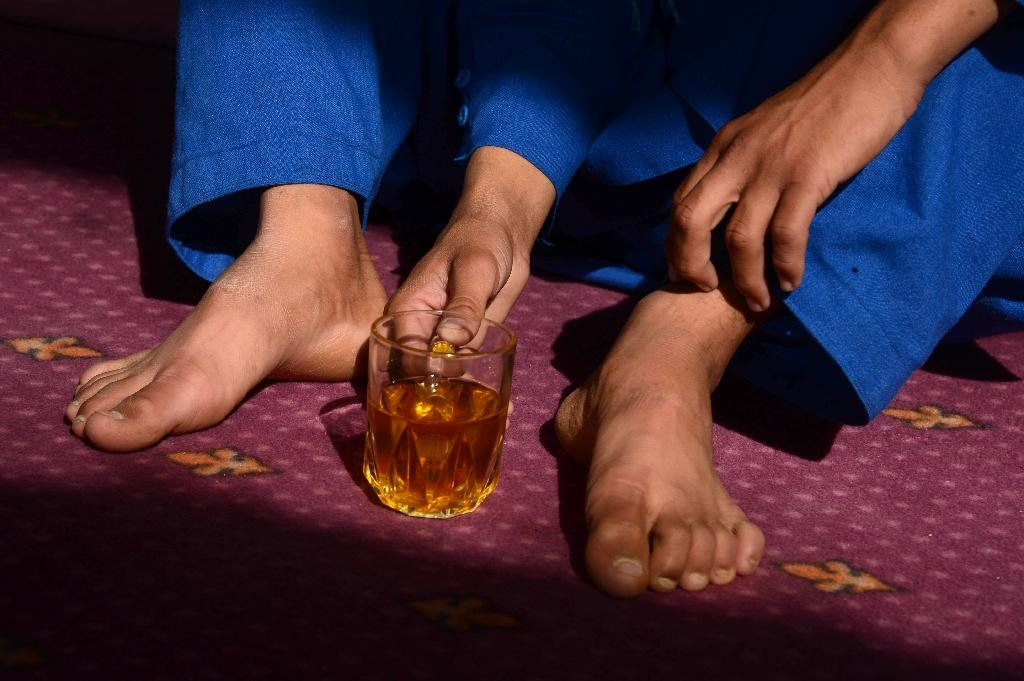 """""""Bacha bazi"""" is not widely seen in Afghanistan as homosexual behaviour -- popularly demonised as a deviant sexual act, prohibited in Islam -- and is largely accepted as a cultural practice (AFP Photo/Aref KARIMI)"""