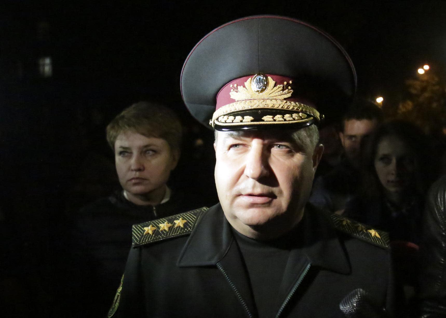 Ukraine's National Guard chief Stepan Poltorak speaks to the media in Kiev, on October 13, 2014