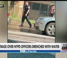 Outrage after NYPD officers are drenched with water while on duty