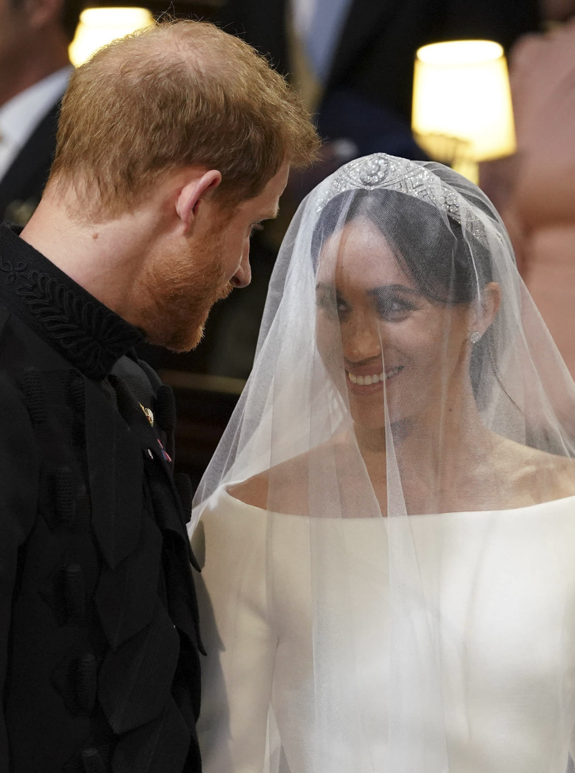 <p>Britain's Prince Harry, Duke of Sussex and Meghan Markle, Duchess of Sussex, stand together at the altar in St George's Chapel, Windsor Castle, in Windsor, on May 19, 2018 during their wedding ceremony.</p>  <p>(Photo by Dominic Lipinski / POOL / AFP)</p>