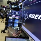 Boeing earnings give a lift to the aircraft maker's shares
