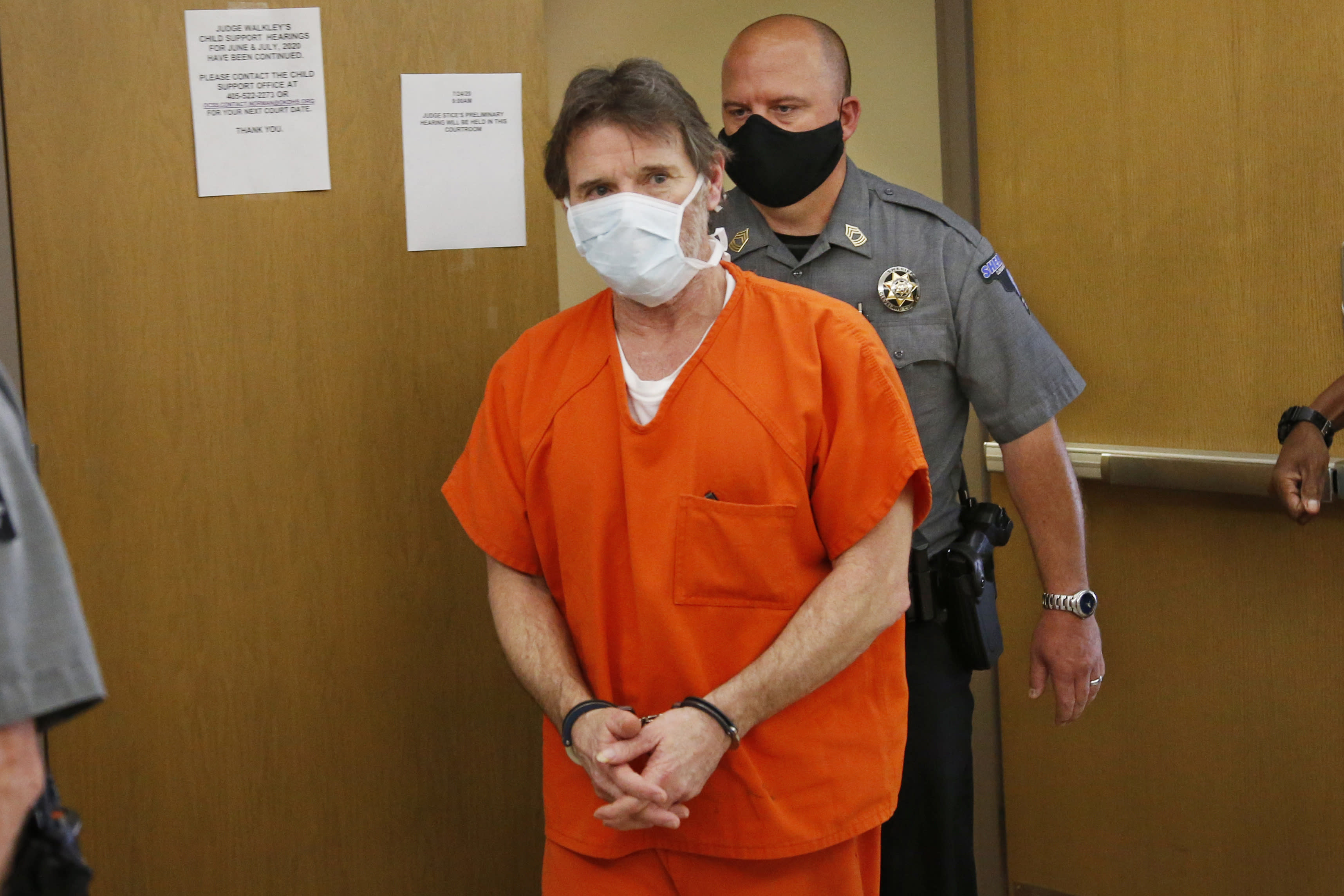 Max Townsend, the man accused of killing three Moore High School cross-county runners and injuring several others in alleged hit and run crash, leaves the courtroom during a lunch break in a preliminary hearing in Norman, Okla., Friday, July 24, 2020. (AP Photo/Sue Ogrocki)
