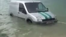 Community rescue van stuck in harbour is rescued by locals
