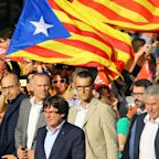 Catalan leader accuses Spain of 'worst attack' since Franco as central government imposes direct rule
