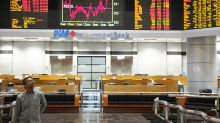 Global stocks, oil slip after Fed points to more rate hikes