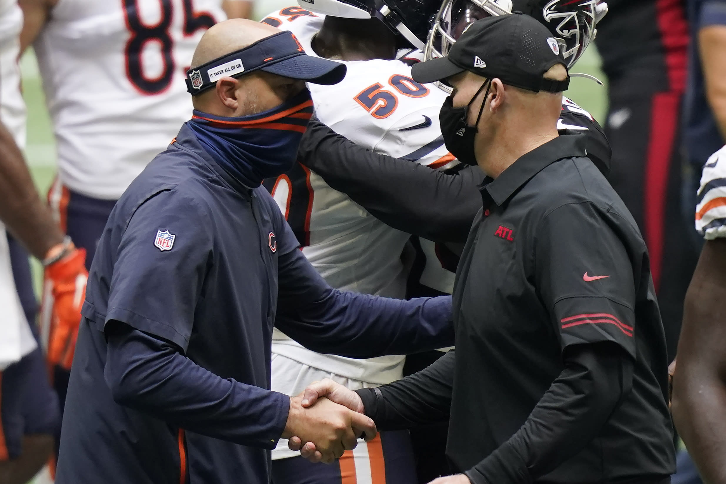 Chicago Bears head coach Matt Nagy speaks with Atlanta Falcons head coach Dan Quinn after an NFL football game, Sunday, Sept. 27, 2020, in Atlanta. (AP Photo/Brynn Anderson)