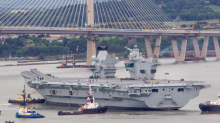 HMS Queen Elizabeth sets sail for first time: 'Big Lizzie' squeezes under Forth Road Bridge