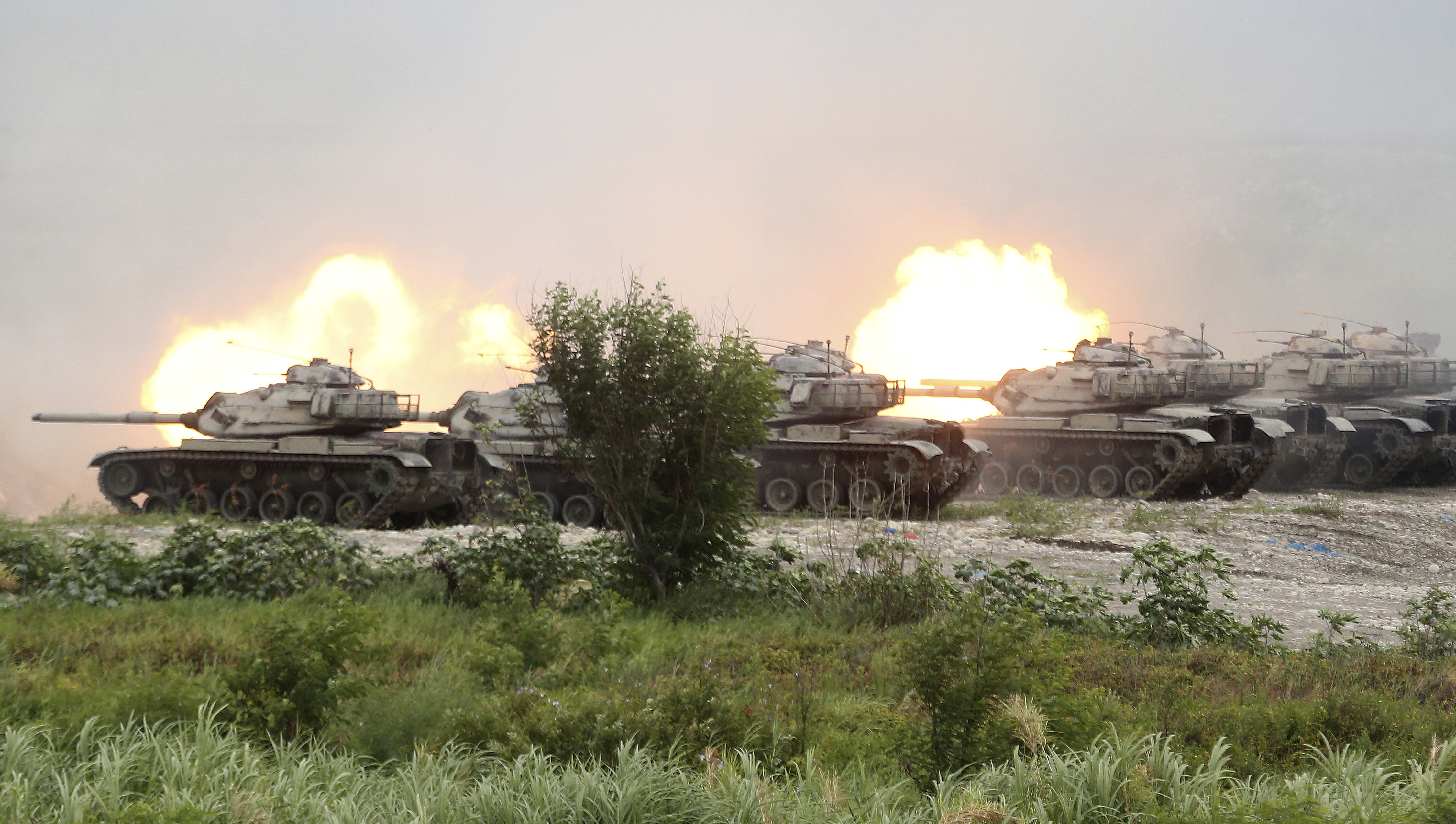 M60A3 Patton main battle tanks in a line fire during the 36th Han Kung military exercises in Taichung City, central Taiwan, Thursday, July 16, 2020. (AP Photo/Chiang Ying-ying)