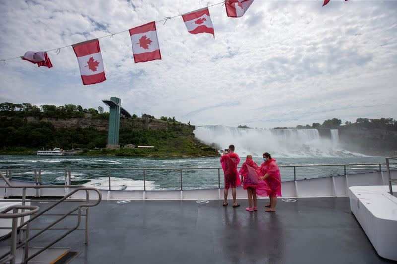 Jose Mannucci, Mariah Wilson and Jasmine Demers ride the Canadian tourist boat Hornblower, limited under Ontario's rules to just six passengers amid the spread of the coronavirus disease (COVID-19), in Niagara Falls