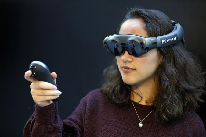 PARIS, FRANCE - NOVEMBER 21: A visitor tries a virtual reality helmet Magic Leap One during the Virtuality Paris 2019 show on November 21, 2019 in Paris, France. Magic Leap is an American startup working on augmented reality technology. The virtual reality show and immersive technologies, Virtuality takes place from 21 to 23 November 2019 in Paris. (Photo by Chesnot/Getty Images)