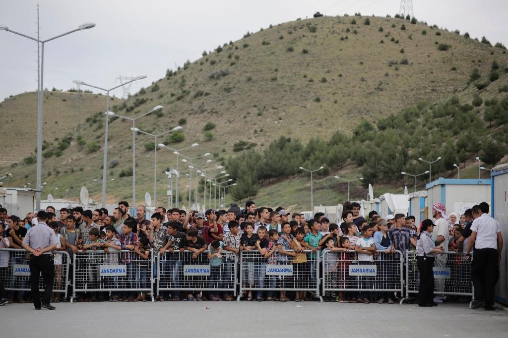 Refugees wait at the refugee camp on the Turkish-Syrian border in Gaziantep, Turkey on April 23, 2016