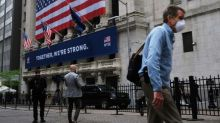 Floor trading resumes at NYSE, with masks and plexiglas