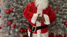 Black Santa comes to town at west Edmonton photo studio