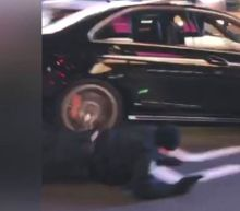 Heart-Stopping Video Shows NYPD Cop Dragged by Car in Dramatic Times Square Chase