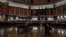 Stocks Rebound as Fed Says No Reason to Rush Rates: Markets Wrap