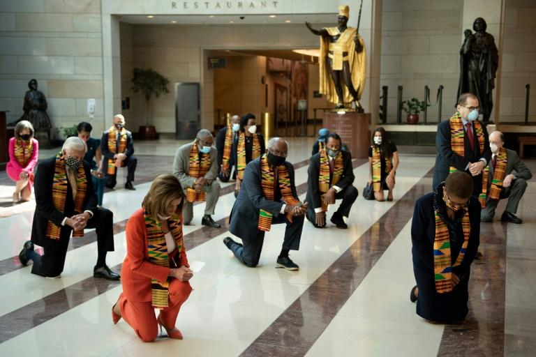 Nancy Pelosi and the Democrats Take a Knee in African Scarves in Congress and Call George Floyd a 'Martyr' to 'Police Brutality' as House Speaker Launches Sweeping Reform Bill but Rejects De-funding Police