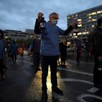 NHS staff and campaigners take part in candlelit vigil in honour of those who have lost their lives during pandemic