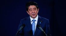 Japan's Abe says wants to resolve peace treaty issue with Russia