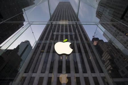 File picture of the Apple symbol tinted green at the Apple flagship store on 5th Avenue in New York