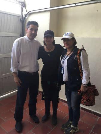 Spanish journalist Salud Hernandez poses with priest Ramon Torrado and government official Marta Bustamante in Norte de Santander