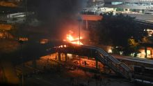 Protesters set fire to hold off police at Hong Kong campus