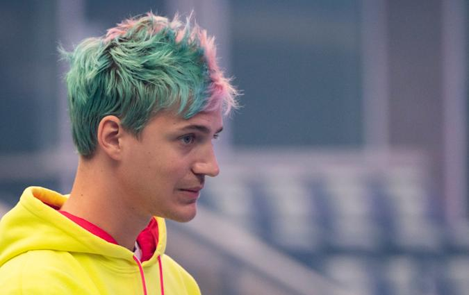 Richard Tyler Blevins, aka Ninja, speaks to the crowd at the start of the 2019 Fortnite World Cup Finals - Round Two on July 27, 2019, at Arthur Ashe Stadium, in New York City. - On August 1, 2019 Ninja announced he was leaving Twitch to take his video-game livestreams exclusively on Microsofts streaming service: Mixer. (Photo by Johannes EISELE / AFP)        (Photo credit should read JOHANNES EISELE/AFP via Getty Images)