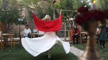 Young Afghan women, men perform whirling Sufi dance together