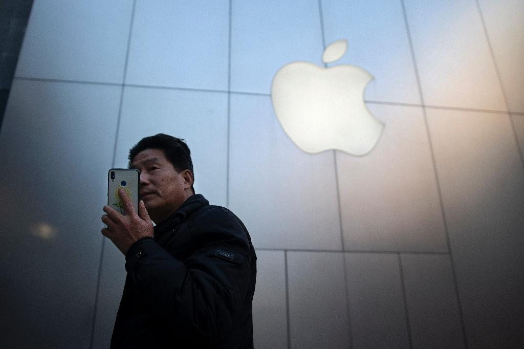Apple could suffer from a backlash in China if the crisis over Huawei persists, according to analysts (AFP Photo/NICOLAS ASFOURI)