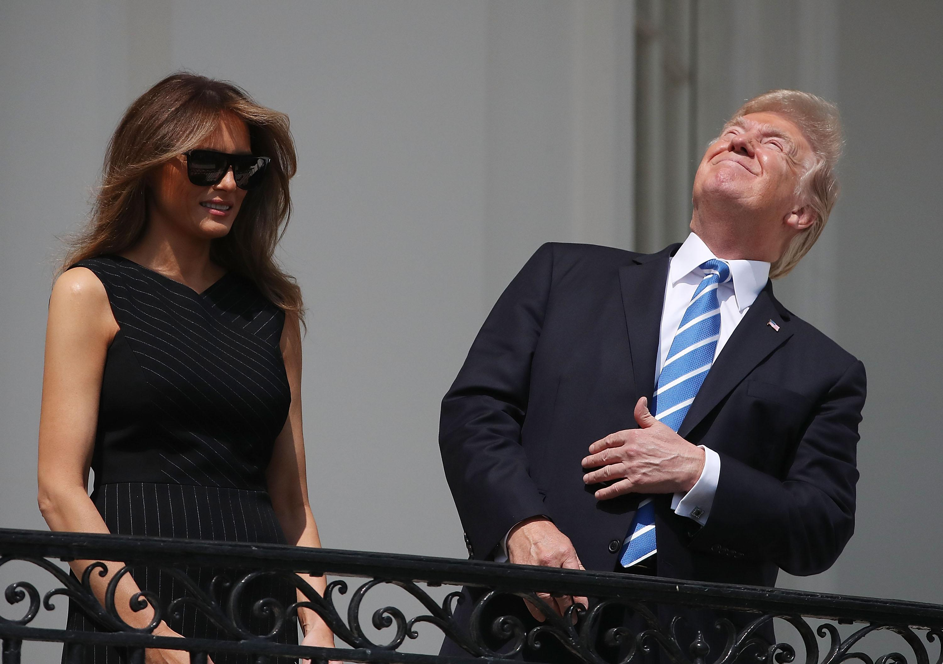 <p>President Donald Trump looks up toward the Solar Eclipse while joined by his wife first lady Melania Trump on the Truman Balcony at the White House on Aug. 21, 2017 in Washington, D.C. (Photo: Mark Wilson/Getty Images) </p>