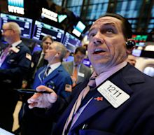 Stocks end lower amid wave of earnings