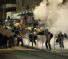 Clashes involving Hong Kong's protest movement grow violent