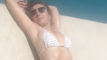 Elizabeth Hurley, 54, writhes by the pool in latest bikini video: 'Bet Hugh Grant is gutted'