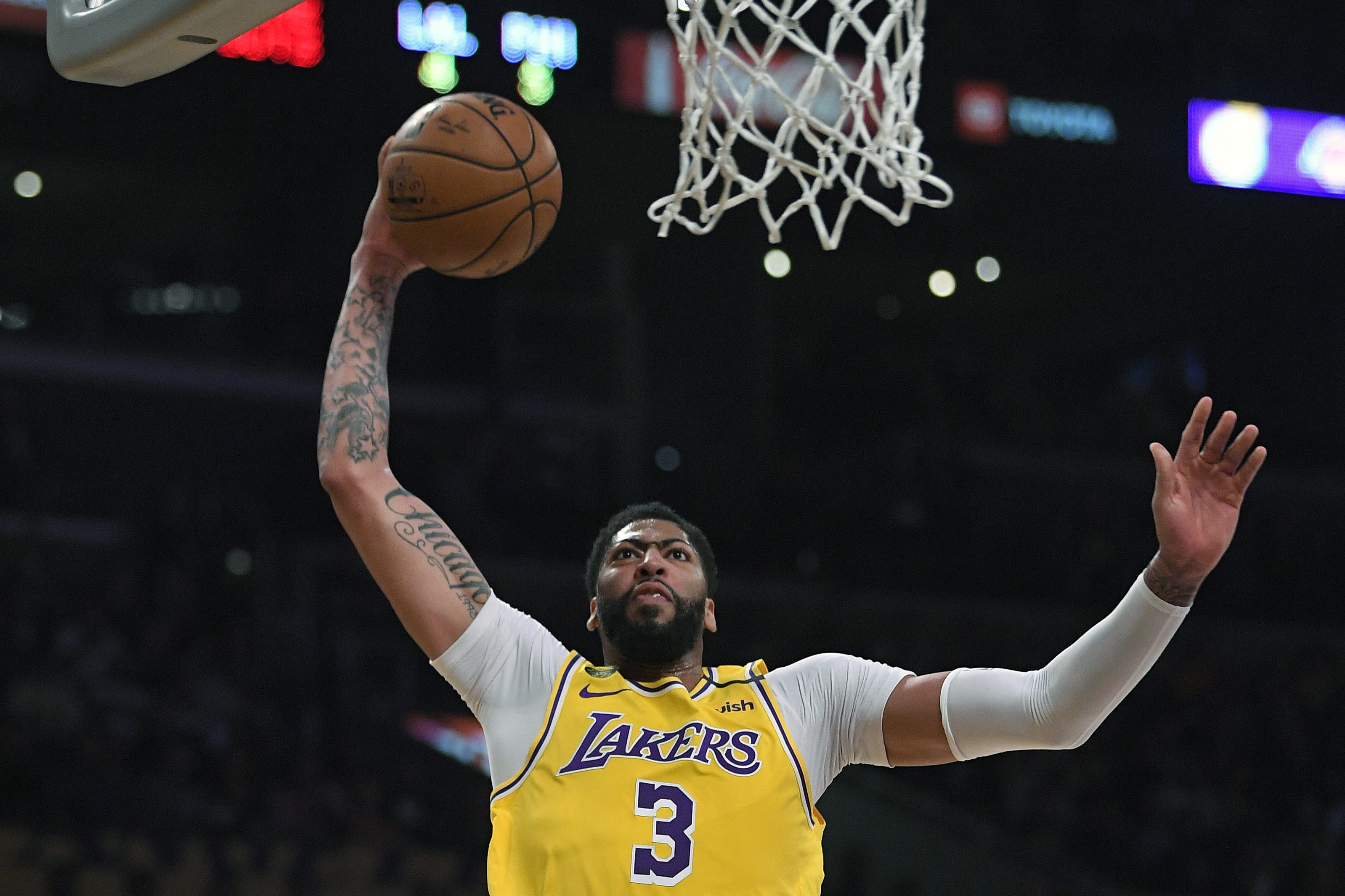 FILE - In this Tuesday, March 3, 2020, file photo, Los Angeles Lakers forward Anthony Davis shoots during the first half of an NBA basketball game against the Philadelphia 76ers in Los Angeles. Davis left his team's scrimmage against the Orlando Magic on Saturday, July 25, 2020, after being poked in the right eye and is listed as day-to-day. (AP Photo/Mark J. Terrill, File)