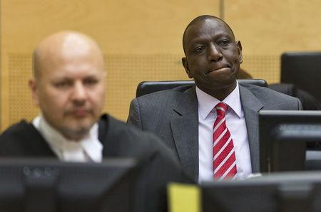 Kenya's Deputy President William Ruto (R) reacts as he sits in the courtroom before his trial at the International Criminal Court (ICC) in The Hague in this September 10, 2013 file photo. REUTERS/Michael Kooren/Files