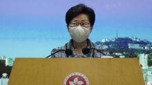 Hong Kong leader seeking Beijing's help for ailing economy