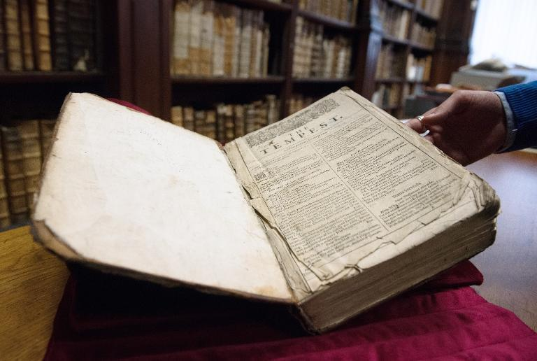 Remy Cordonnier, librarian in the northern French town of Saint-Omer, carefully shows on November 25, 2014 a valuable copy of William Shakespeare's First Folio, a collection of some of his plays dating from 1623 (AFP Photo/Denis Charlet)