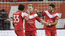 Duesseldorf stuns Dortmund 2-1 as leaders fall to 1st defeat