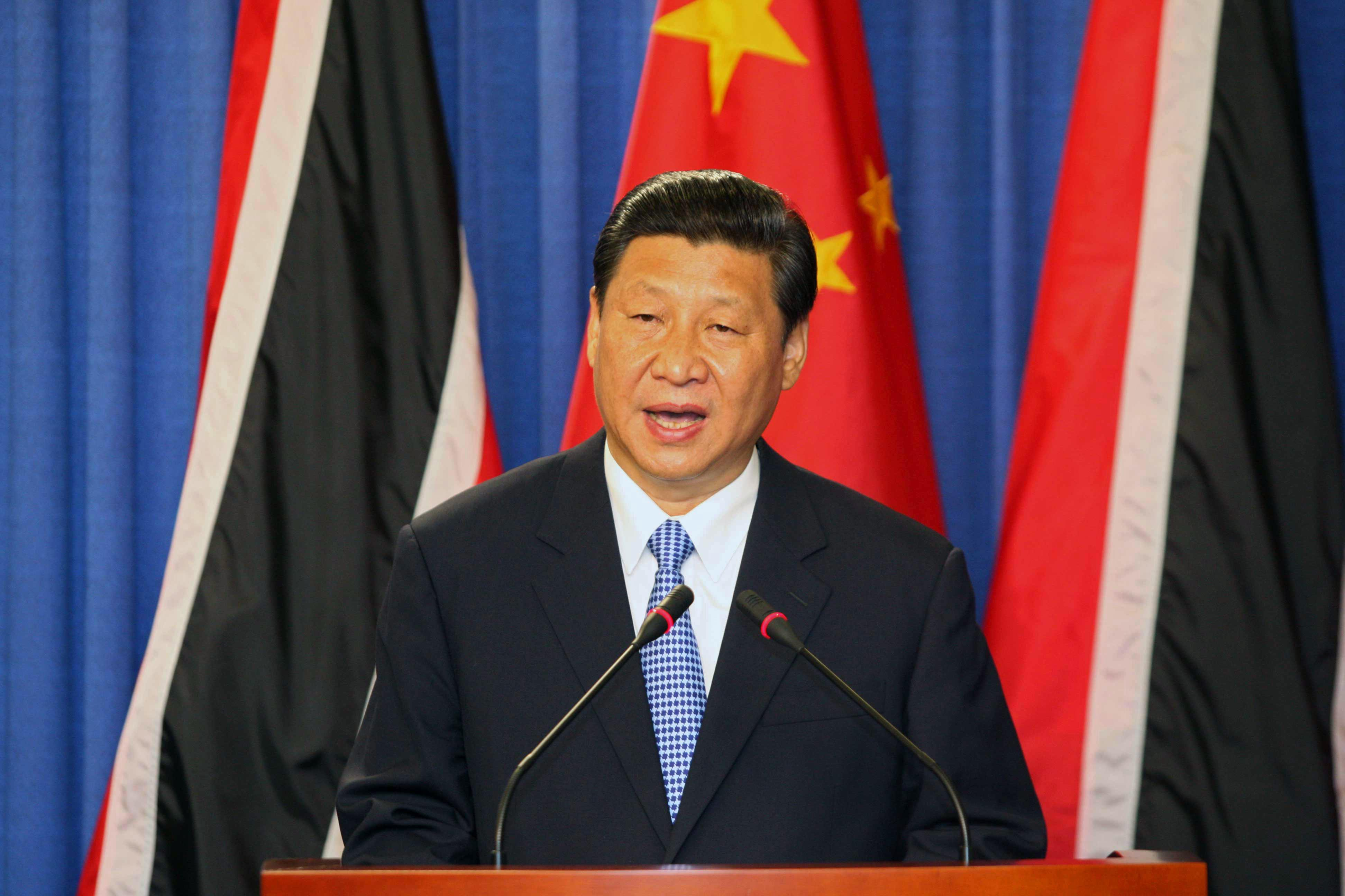 China's President Xi Jinping speaks during a joint news conference with Trinidad & Tobago's Prime Minister Kamla Persad-Bissessar, unseen, at the Diplomatic Center in St. Ann's, Trinidad, Saturday, June 1, 2013. Xi Jinping announced China was awarding Trinidad a $250 million loan to build a children's hospital during the first stop of his four-country regional tour in the Americas. He's also traveling to Mexico, Costa Rica and the U.S. (AP Photo/Anthony Harris)