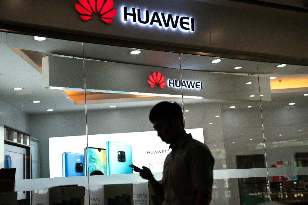 Chinese tech giant Huawei is seeking its own mobile operating system and processors in the face of a US ban (AFP Photo/FRED DUFOUR)