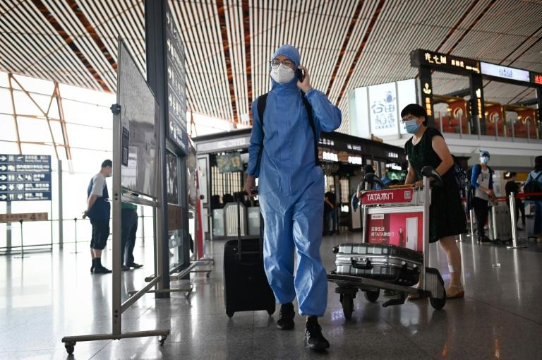 Beijing's airports have cancelled hundreds of flights over the latest cluster (AFP Photo/STR)