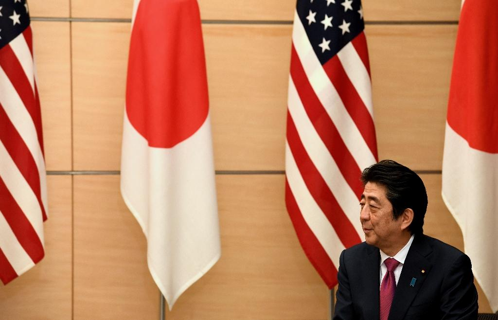 Shinzo Abe speaks in Tokyo on December 21, 2016 at a joint announcement of the return of US military land on the island of Okinawa (AFP Photo/Toshifumi Kitamura)