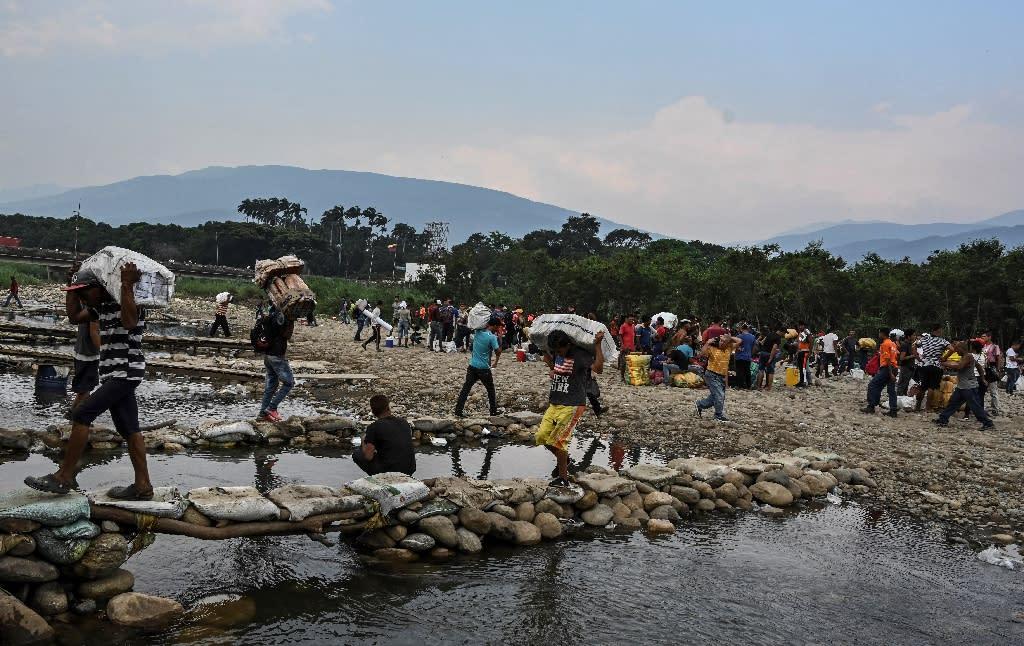 People smuggle goods into Venezuela along illegal cross-border trails between Cucuta, Colombia and San Antonio del Tachira, Venezuela