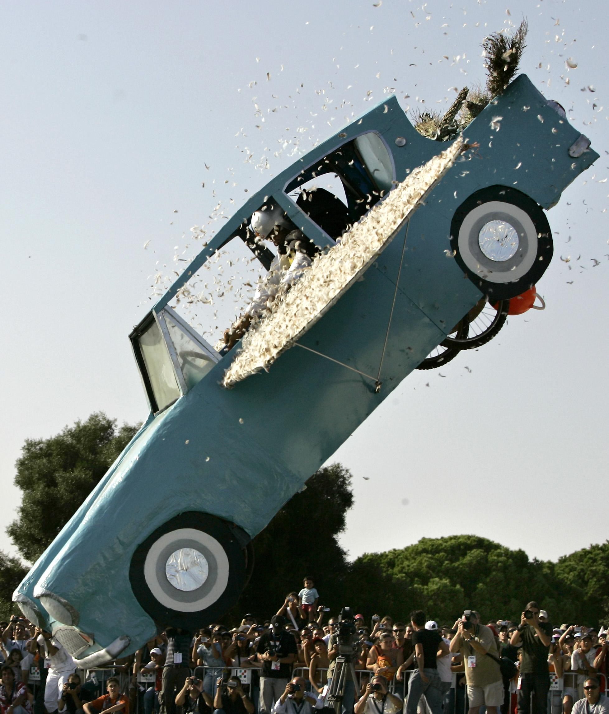 The car of Ana Catarina Durao loses its wing feathers and heads towards the river Tagus during a Flugtag, Wings' Day, sponsored by a soft drinks company, Saturday, Sept. 9, 2006, in Lisbon, Portugal. Thousands flocked to the river bank to watch the 50 contestants and their flying machines participating in the second edition of the Lisbon Flugtag. (AP Photo/Armando Franca)