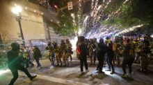 Portland protests: Federal agents swarm American-flag bearing demonstrator as clashes continue through night