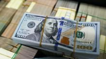 Dollar holds awaiting signals on trade, Fed policy