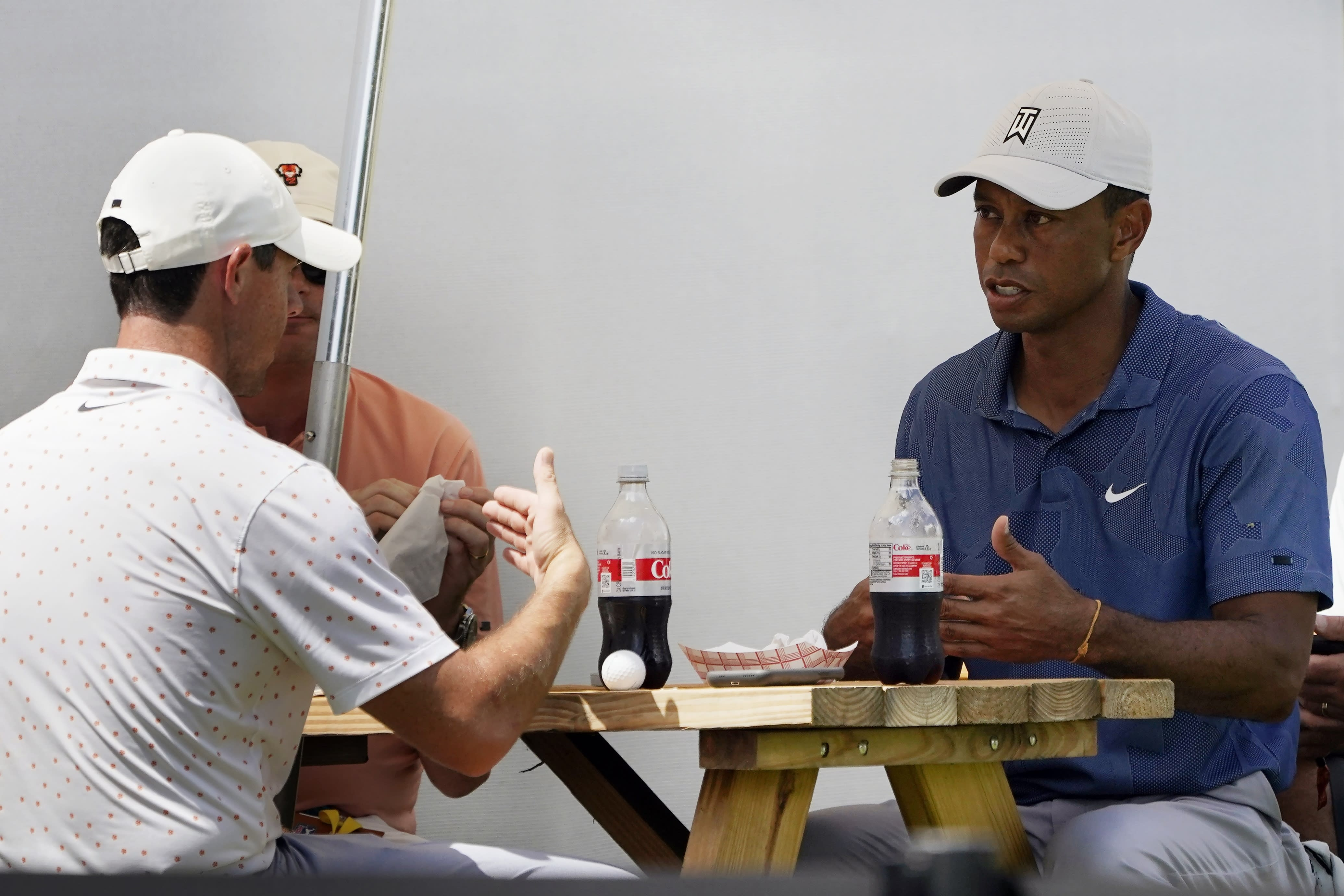 Tiger Woods, right, has lunch with Rory McIlory, left, during the third round of the Northern Trust golf tournament at TPC Boston, Saturday, Aug. 22, 2020, in Norton, Mass. (AP Photo/Charles Krupa)