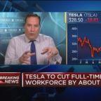 Tesla lowers fourth quarter profit guidance