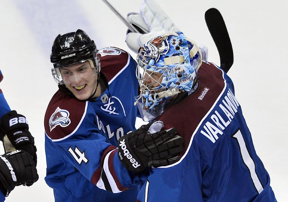 Barrie tips in OT winner as Avs beat Canucks 3-2