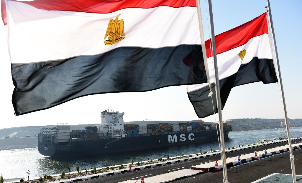 A cargo ship crosses a new waterway at the Suez Canal during its opening ceremony on August 6, 2015, in the Egyptian port city of Ismailiya (AFP Photo/Mohamed el-Shahed)